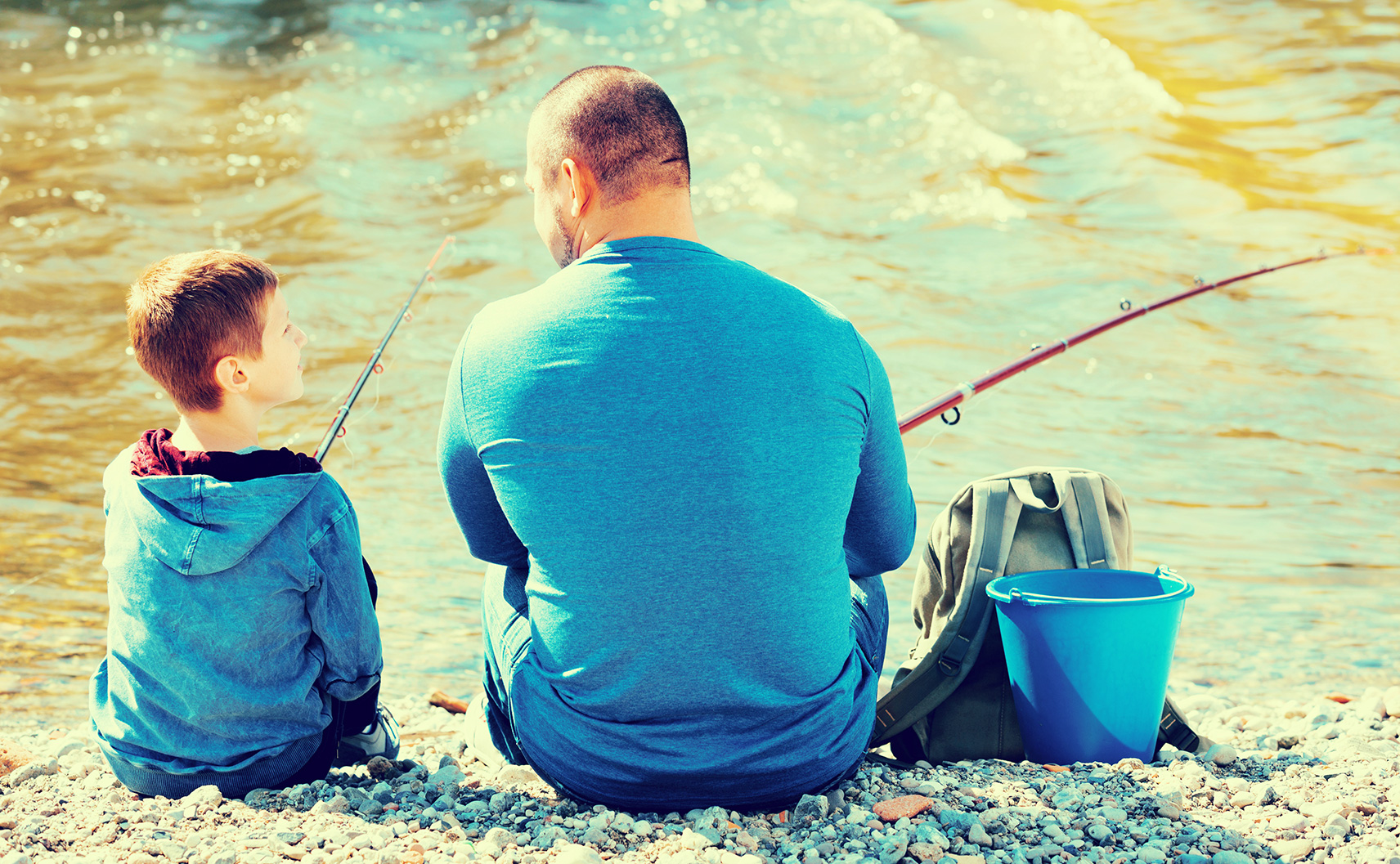 Father & son bonding over fishing