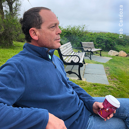 Man Relaxing in Early Morning on Block Island with Coffee