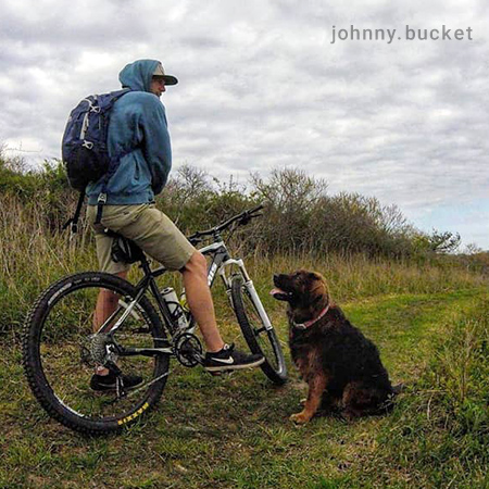 Young Man Riding Bicycle with A Dog